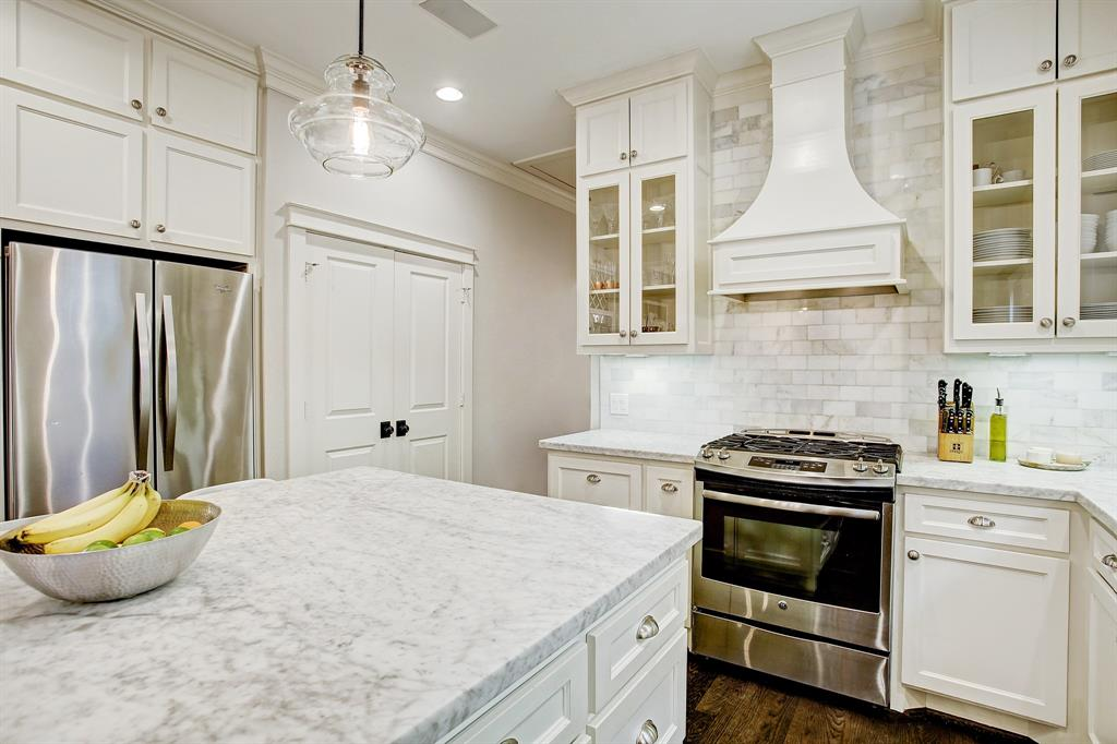 Note the tile all the way to the crown molding surrounding the highly crafted vent hood.  A kitchen for the most discerning chef, with tremendous counter space.