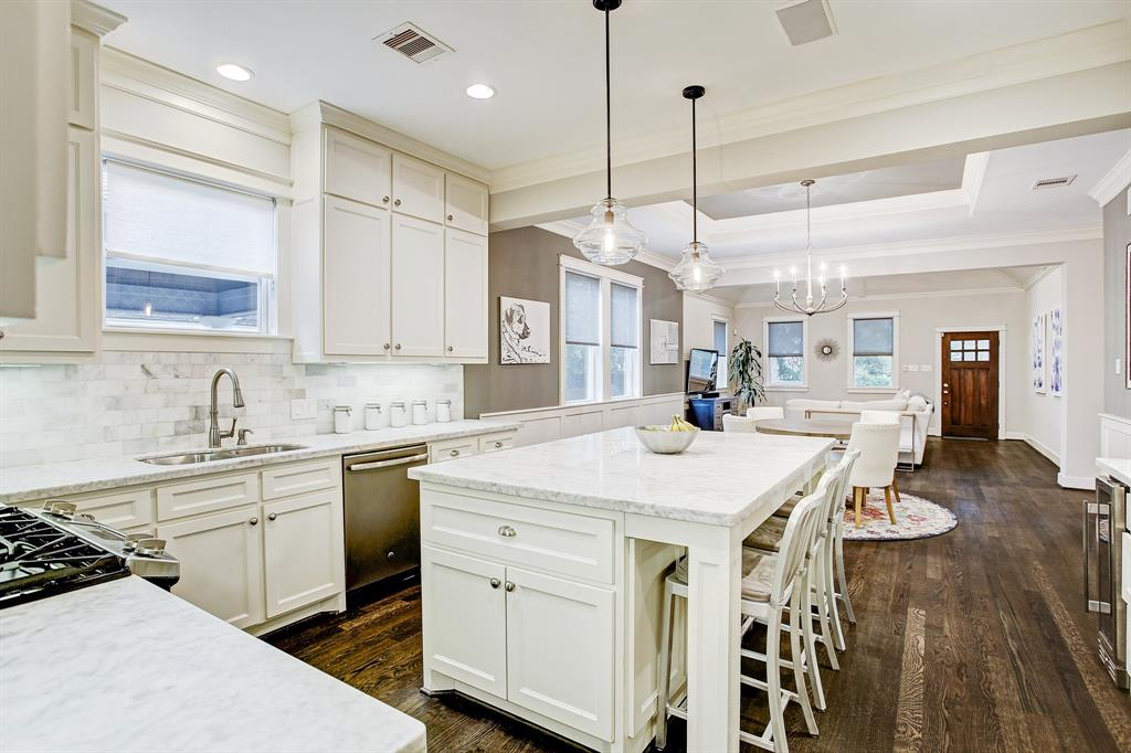 So much attention was paid to details in rehabbing this home, including light fixtures, beautiful crown molding and chair rail paneling.  What a place to live and entertain!