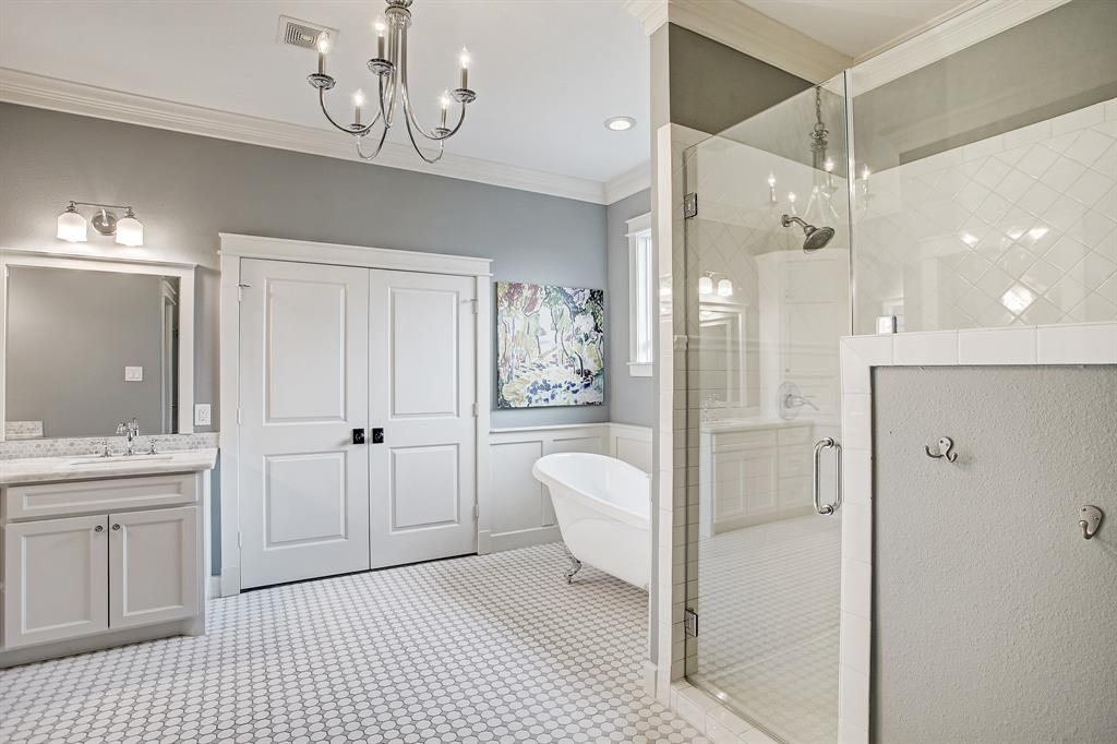 The primary bath includes an over sized shower stall and soaking tub.  The double doors lead to the walk-in closet (see attached Matterport video for a peek inside).