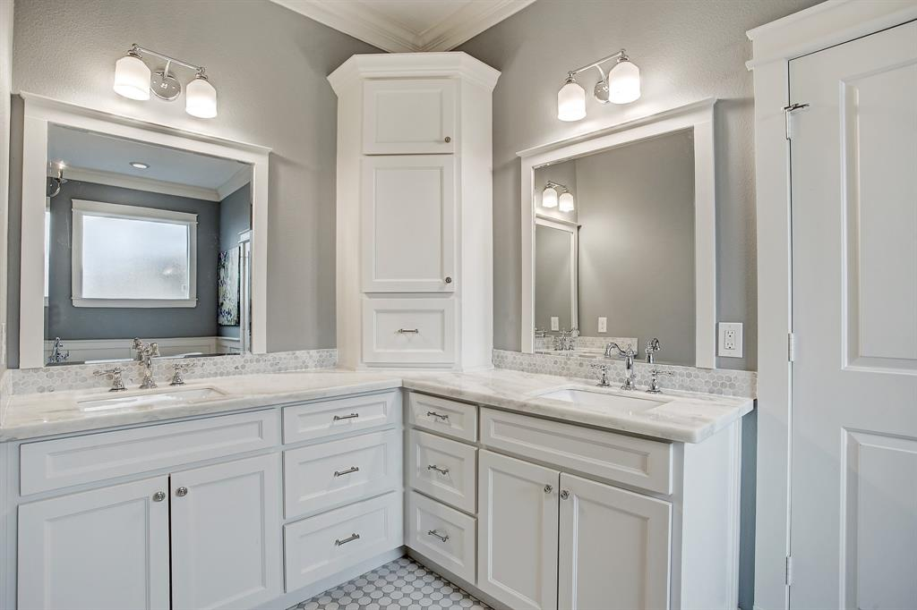The primary bath is as finely finished as the kitchen, with loads of cabinet and drawer space.