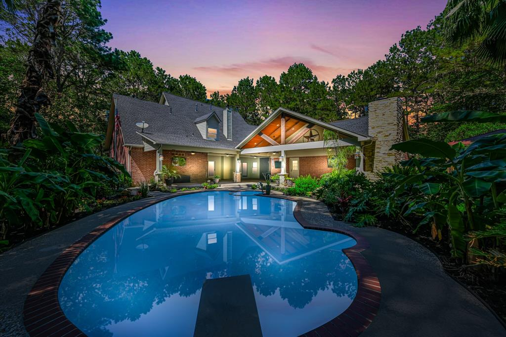 WOW! Very rare hard to find in Katy*You won't find another home like this at this price in Katy, it simply doesn't exist!This home is stunning & sits on 3.20 heavily wooded acres w/sparkling pool/spa! Stylish & peaceful country living w/all the modern luxuries of a big city-doesn't get much better! Phenomenal outdoor entertaining area w/ 1280 sqft of covered patio, fireplace, wood stained beams, entertainment/sound system w/satellite capability, pool bath, outdoor fireplace. Tons of fruit trees. Island kit w/upgraded appliances & tons of upgraded cabinets. Wet bar/coffee bar. Den w/fireplace overlooks pool w/patio doors. Upgraded master bth. Recent roof. Hardwood floors. Mosquito misting sys. Leaf guard gutters. LG utility rm. There's nothing else like this on the market in Katy for this price! Minutes to downtown Katy, I-10 & 99. LOW TAX RATE. Lot is so private, i's hard to believe you're in Katy! Don't miss 3-D virtual walk-through tour-click on the movie reel at the top of the page