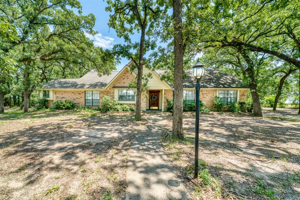 4,000 SQUARE FEET 4/3 ESTATE on 1.5+/- ACRES!!! Bring the welcome mat, this enormous home has more than enough room!  Nestled in a small forest of majestic oaks could be a charming bed and breakfast? Perhaps your needs room to grow?  With 4 nice sized bedrooms, walk-in closets, and baths to match you won't be stepping on any toes, but the huge living room and kitchen/dining area were designed for family gatherings.  Imagine your own media room, game room, craft room, man cave and more with multiple bonus rooms throughout the house.  This estate was created by one of the finest home builders in the area, and his workmanship is evident throughout. Relax to the serenity country life provides on your beautiful back patio.  Fill your new shop with unfinished projects or easily convert it into a mother-in-law suite.  Potential is limitless in a great school district, with business booming in town only a few miles away. An hour from Houston is just far enough.