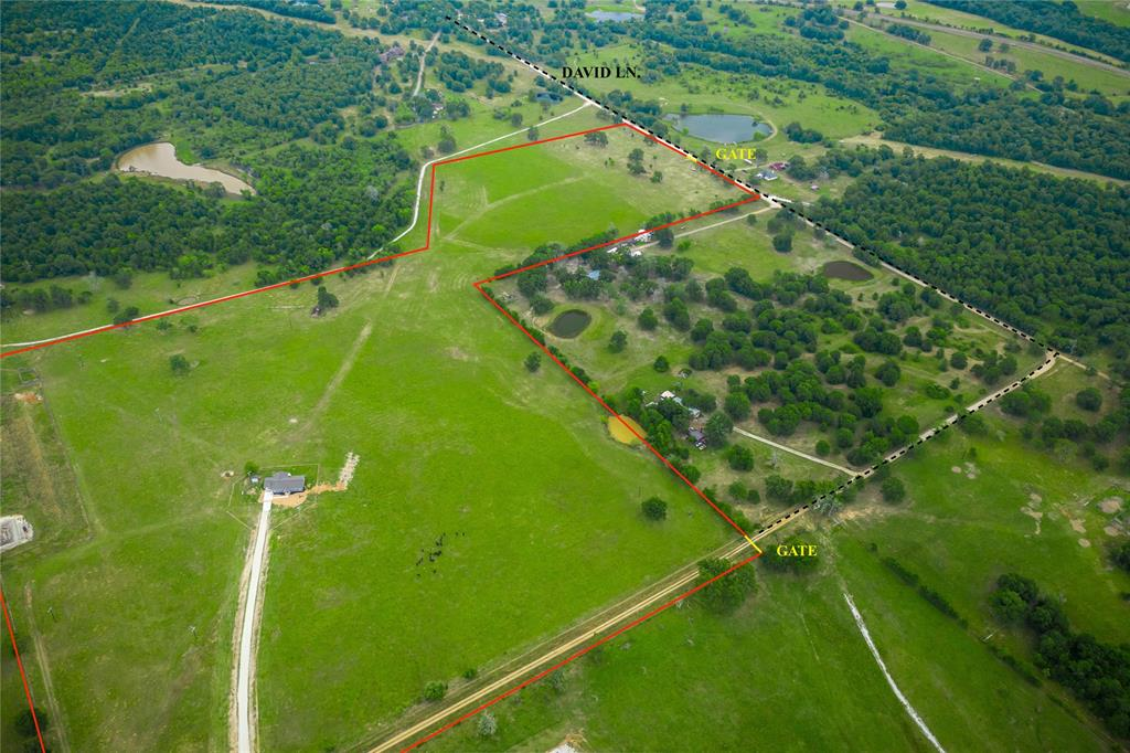 Premier opportunity, 51.71 acres just 30 minutes from B/CS. Located in the western portion of Madison County bordering Brazos County, this turnkey property has much to offer for anyone looking for an ideal weekend retreat, or permanent residence. New custom-built 1,825/sf ranch-style home situated atop a drastic hilltop surrounded by gorgeous rolling pastures provides excellent country side views. The 3 bed/2 bath residence features an open layout w/ stainless appliances, granite countertops, large kitchen island, gas fixtures, walk in pantry, wood burning fireplace, large picture windows & wet bar equipped with a wine cooler. Interior rooms include the master suite w/ his & her sinks, tile walk in shower, walk in closet, two additional bedrooms, bathroom, laundry/mudroom, new septic & HVAC system. Exterior highlights include large front/back covered patios, attached carport, & new 300+ft caliche driveway. This welcoming property is ready for it's new owners to enjoy.