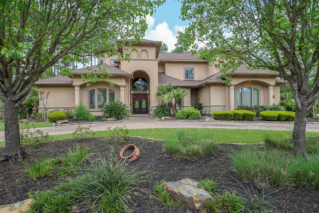 Casual, yet luxurious both describe this home on the 15th hole of the Player Golf Course! From family BBQ's in the backyard, poolside, to the travertine floors, custom moldings, grand staircase that will impress all your guests!  Walls of windows blend these together, offering views and natural light! This gorgeous Mediterranean home with circular drive is quite stately. Entertain in the formals, while enjoying views of the back with pool, beautiful landscaping and the golf course! The kitchen and family room are tucked away for privacy. You will love every opportunity to retire to this master suite! Enjoy movies in the media room! Second bedroom down and each bedroom has an ensuite bath! With this near half acre lot and the green space to the side, this is the ultimate in privacy, yet, still able to enjoy the views of the Player course! Enjoy The Woodlands lifestyle with nearby parks, dining, shopping & events! No need to travel, vacation time is at your fingertips!
