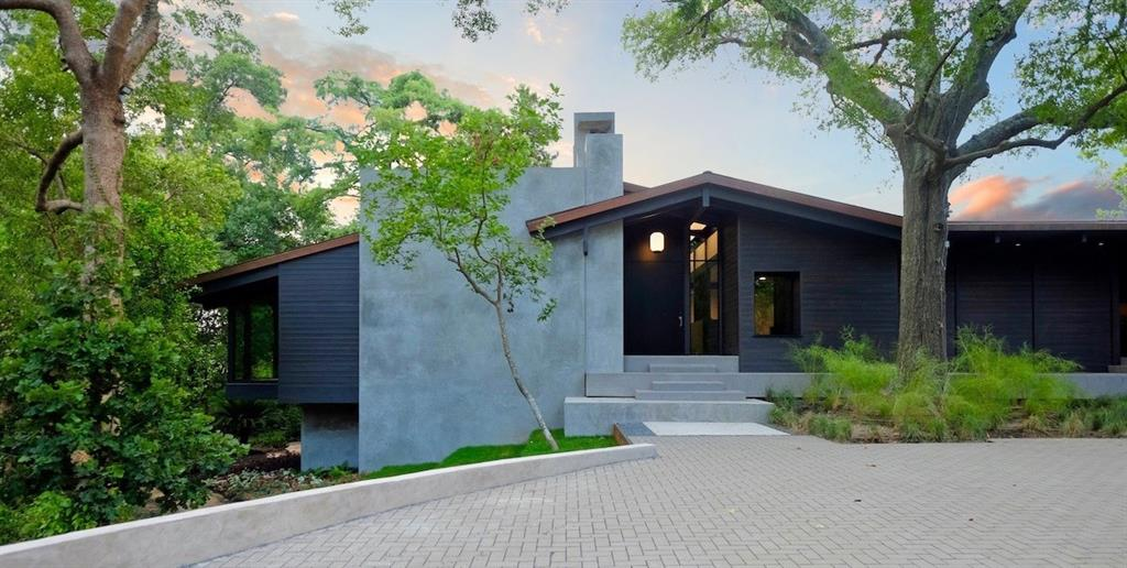 This is a once-in-a-lifetime opportunity to own an incredible two acre property in one of Houston's most bucolic, serene settings. 2 Tiel Way is truly a piece of art created by renowned architect, Christopher Robertson. Designed to pay homage to the original MacKie and Kamrath home that once occupied the site, this home honors the modernist aesthetic of mid-century design but offers the amenities and features we've come to expect in new construction. Using only the finest craftsmen and materials, this home is truly special. From the copper roof to the Siberian Larch wood, to the warm gray Texas limestone flooring, simplicity and elegance define the spaces. Whether your enjoying morning coffee by the pool on the expansive lawn, or taking a stroll through the shaded rain forest-like ravine garden, every inch of this property offers unparalleled views and experiences. Note: the rear acre is a separate lot (with its own legal description) that the buyer could sell later and/or build on.