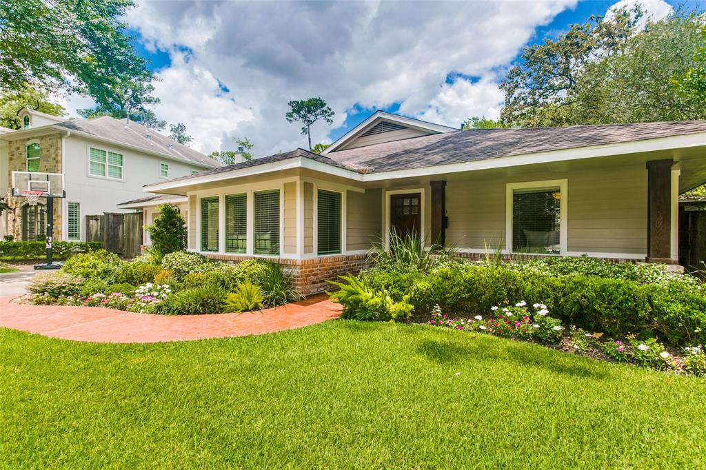 This Spring Valley home was recently renovated and is located on Spring Branch Creek. It is a very private, heavily wooded home with a large fenced backyard, and sits on a 13,998 sq. ft. lot.  The 3/4 BR or Study, 2 BA 2,538 sq. ft. house has oversized windows throughout that provide lots of light with views to the wooded lot and creek. The property has never flooded, sitting high above the water. The home is move-in ready, and one of the last remaining