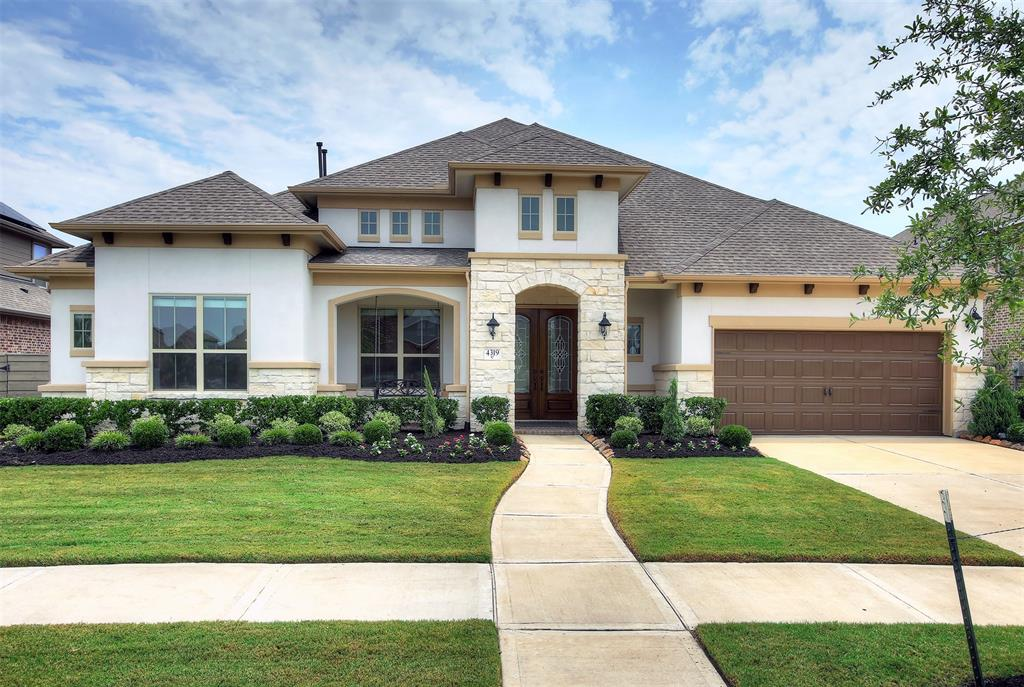 This extremely upgraded open concept home is graced with high ceilings, a dramatic entry, and rich wood flooring. Only 20 minutes to Downtown and 15 min to Medical Center. A distinguished stucco and brick exterior gives this home fabulous curb appeal. The kitchen has an oversized island, wine cooler, beverage cooler, endless cabinets, granite/quartz countertops, water softener and stainless appliances.  Enjoy a theatre experience in your own media room.  The fun extends to your covered patio with outdoor kitchen, retractible Outdoor TV, extended patio, and huge backyard.  A 3 car garage gives you the option to have a great work place.  Close proximity to 288, newly completed Amenity Building (2020), Fish Camp, The Backyard (2020), resort style pool, running trails, and local elementary!  This one won't last long.