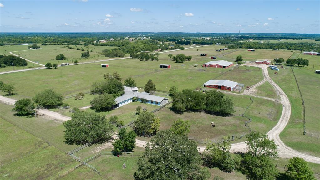 Features 1300 + feet fronting FM 362 and 1000+ feet fronting CR 306 over a mile of interior ranch roads and 408 ft. of elevation granting fabulous long-distance vista views. 12,000 SF hay barn 4,000 SF general barn plus another 2,400 SF barn and multiple paddocks with run-in barns. The original ranch home needs a lot of work but could be used as a camp house until you get a new home built. Two ponds plus a wet weather creek that offer a lot of charm and wildlife habitat. This ranch is easy to show, call anytime for a personal tour or to set up an appointment to show.  Additional property available, see photos.  This property listed 4 ways.