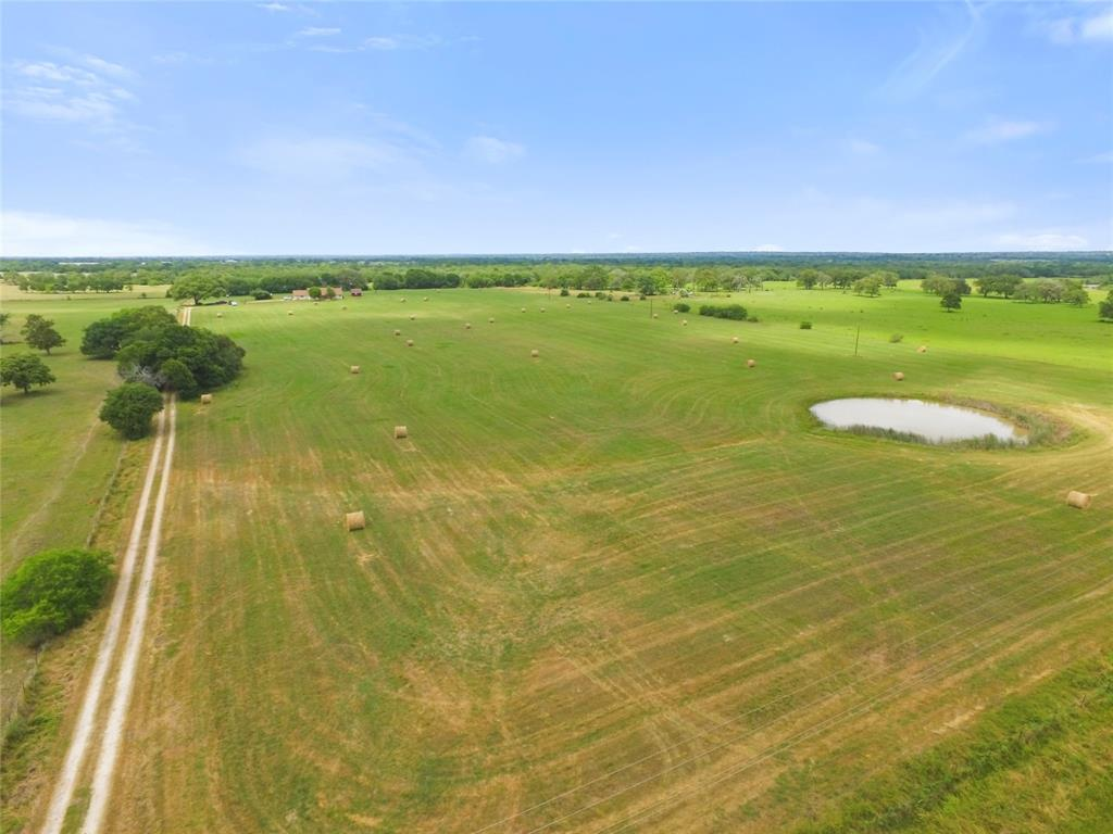 Located in Colorado County just 14 minutes south of Weimar on paved Harmony Rd, this 281.499 acre wooded tract provides a quiet country setting for rancher, outdoorsman, weekender and/or resident looking to escape the fast-paced city life. A 3BR/2.5BA, brick home built in 2002 with 2,072 sqft of living space provides comfortable accommodations featuring an open floor plan, vaulted ceiling in family room, wood burning fireplace, spacious master bath, front/back porch with views & attached garage. The property has unmatched diversity highlighted by open areas for livestock grazing, hay field, 3 small ponds, abundant wildlife for hunting or observing, 60' of elevation change (280'-340') throughout, sandy loam soil, no pipeline or oil/gas well, interior gravel road system & live West Sandy Creek.