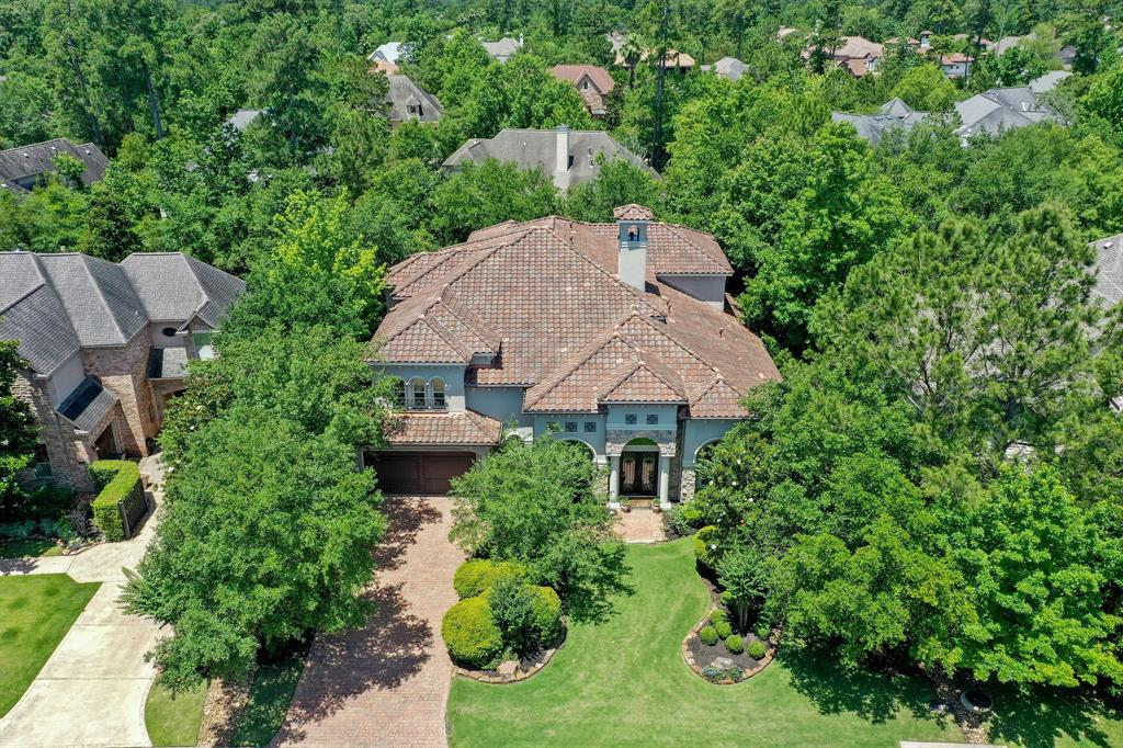 Absolutely gorgeous, expertly-crafted executive home in the lovely, gated Country Club community of Carlton Woods. From the glorious salt-water pool and spa, beautiful hand-made cabinetry, travertine floors, high ceilings, dramatic entry and stunning library, to the 3 gas fireplaces, wine room, luxurious master bath and private 1st floor guest suite, this lovingly-maintained, 5 bedroom home is elegant and sophisticated, yet inviting and warm. Gorgeous butted glass windows throughout the enormous chef's kitchen bring the outdoors in, and a beautiful hearth and attached family room truly create the heart of this home. Upstairs are 3 sunny bedrooms, an enormous game room with custom built-ins, fireplace and bar as well as a huge, step-down bonus room, featuring an adorable built-in seating bench. Close to shopping and dining and zoned to award-winning Conroe ISD schools, as well as a **$60,000 credit** towards a Carlton Woods Golf Membership, it's the perfect place to call home!