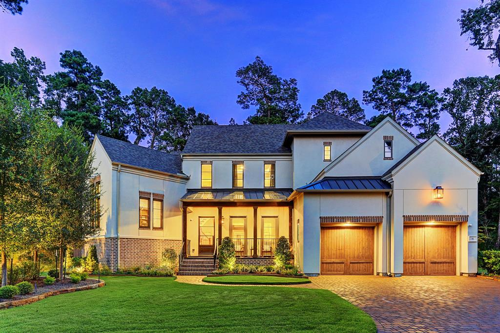 An exquisite, transitional home offering timeless, understated elegance is situated in a gated community in The Woodlands, backs to the George Mitchell Preserve and boasts a mezzanine work-from-home office with shiplap paneling, French doors and 2 cable connections. Beautiful home features custom finishes, open floor plan, & covered deck w-summer kitchen & fireplace extending along back of home. With impeccable architecture & decorator's touch, the home boasts soaring ceilings, hardwood floors, exposed beams, plantation shutters & chef's kitchen w-12'x5' island, commercial-grade appliances - custom vent hood, built-in coffee/expresso machine, 2 dishwashers & gas range. Tranquil master provides luxurious bath w-marble floors, oversized shower, modern tub & huge custom closet. Add'l amenities include guest bed & media down, game room up w/balcony, oversized 3-car garage w-epoxy floors & built-in work/storage area. Huge backyard w-room for pool.