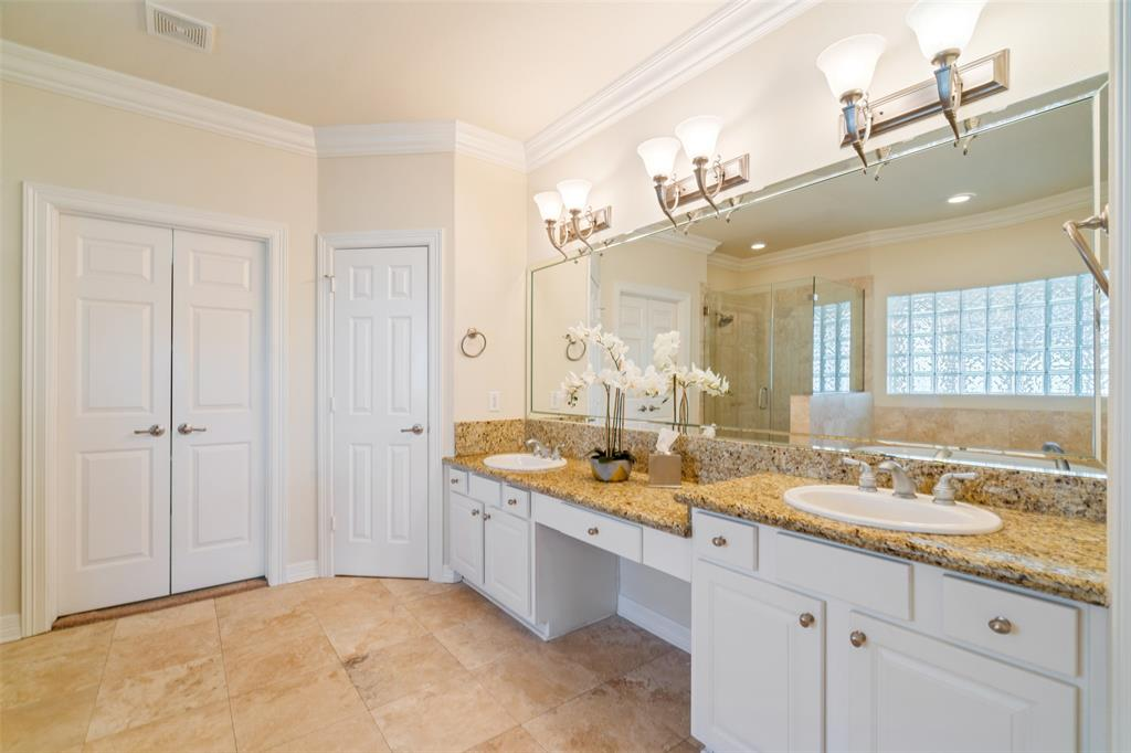 The master bath also features dual vanities and lots of storage.
