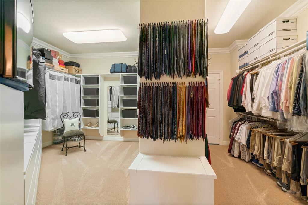 The massive walk-in closet features lots of built-in storage and a bonus storage room.