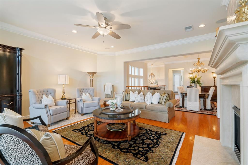 The open floor plan features wood floors, crown molding, recessed lights and lots of built-in storage.