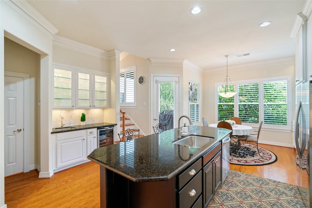 The updated kitchen also features a wet bar, breakfast space and access to the balcony.