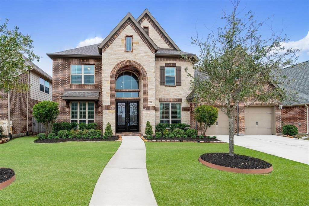 Prestigious Cinco Ranch NW beautiful 5 bedroom with 2 bedrooms down, 4.5 bath with private study, theater style media room and full of upgrades.  Double height entry to elegant wood floors that carry throughout the first floor and stately curved stairs.  Formal dining with butlers pantry, designer fixtures and ready to entertain.  Large private study perfect for working form home.  High design kitchen with upgraded granite, designer finished cabinets, central island and open to the living room great for being together.  Floor to ceiling stone fire place in open living room.  Spacious master with huge closet plus second bedroom downstairs with full bathroom.  Your own theater media room with raised seated theater seating included, mini fridge, equipment included.  Game room up and 3 more bedrooms.  Perfectly situated with no rear neighbors and large covered patio out back.  3 car garage.