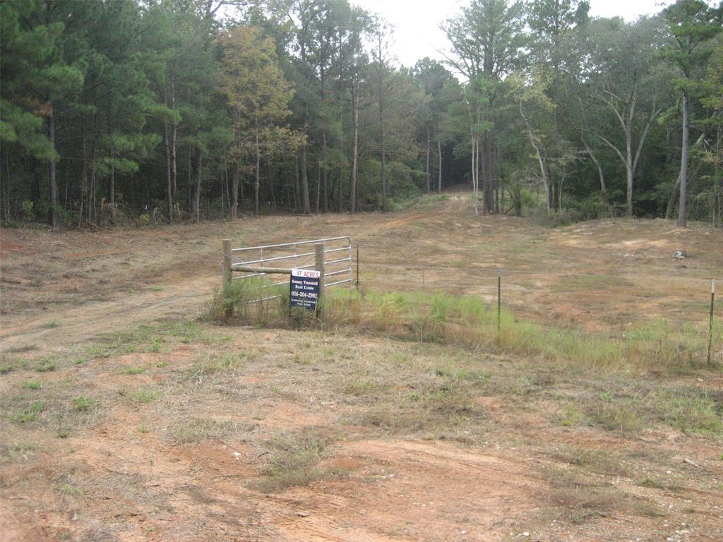 57.366 SECLUDED TRACT. OPPORTUNITY AWAITS FOR YOU WITH THIS  HEAVILY WOODED PROPERTY. ROLLING TERRAIN WITH TWO CREEKS RUNNING THROUGH THE PROPERTY, PROVIDING ABUNDANT WATER SUPPLY FOR WILDLIFE. SEVERAL BUILDING SITES. UTILITIES AVAILABLE.