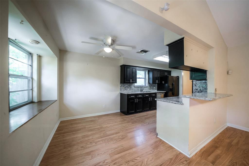 Open kitchen and breakfast area. Gleaming wood laminate. Ceiling fans throughout.