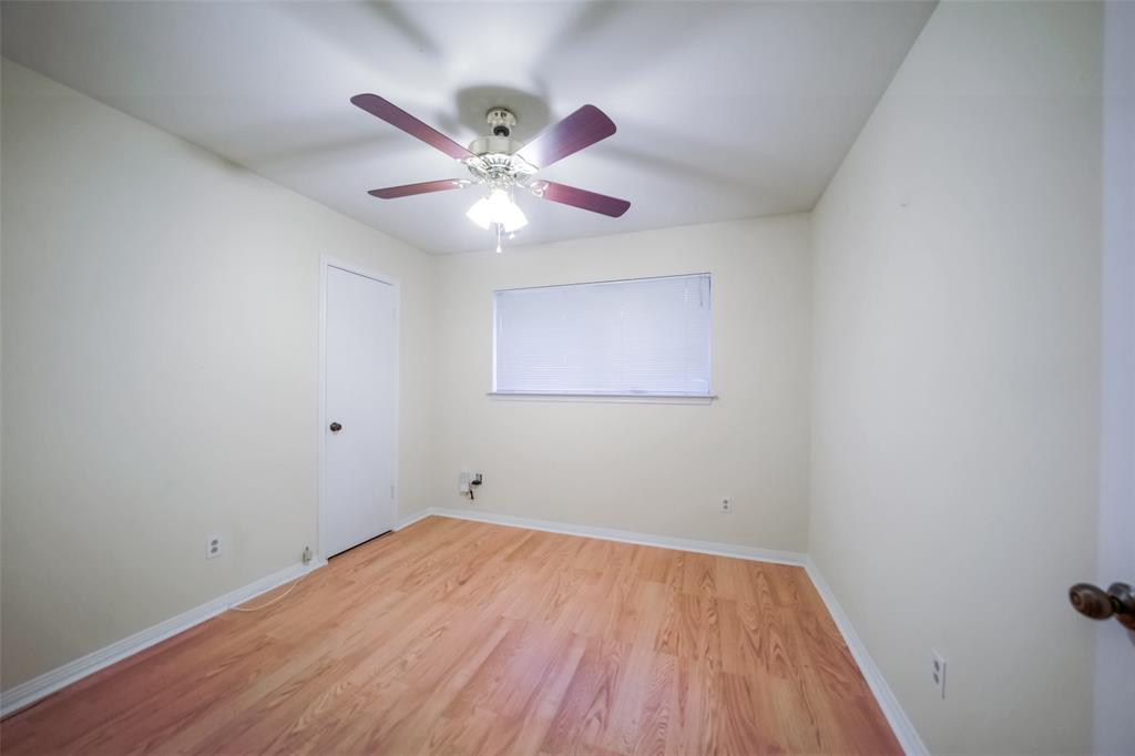 4th bedroom or an office with window, closet and ceiling fan.
