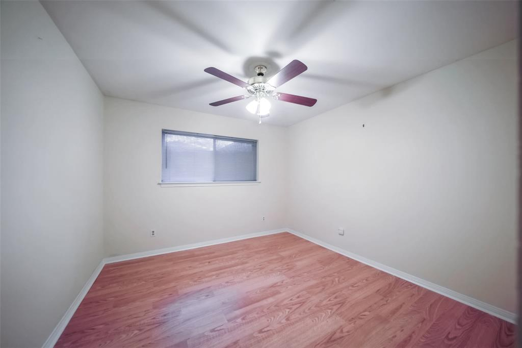 3rd bedroom with window, closet and ceiling fan.