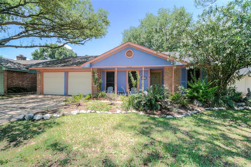 Attractive four bedroom home on sizable wooded lot.