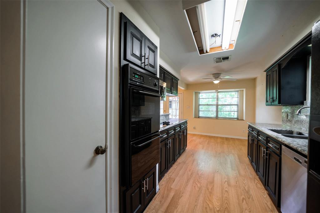 Useful updated kitchen. Handsome black appliances. Appropriately placed pantry. Gas line for stove if you choose to use it.