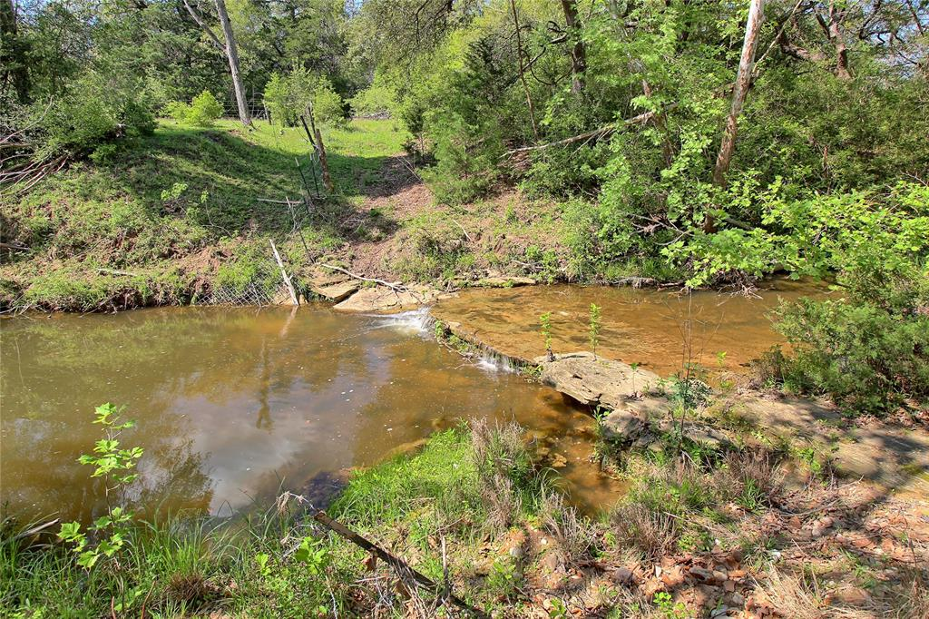 This 162 acre heavily wooded recreational tract offers a quiet country setting for weekender, outdoorsman or home builder. Located in Colorado County near Frelsburg just 12 miles north of Columbus I-10 Exit 696 & within 1 hour of Buc-ee's in Katy, this unique property is highlighted by a 10+/- acre cleared area with scattered, mature trees along live Piper Creek with large sandstone boulders, century old Live Oaks & trickling waterfalls. The property has road frontage on Cummins Creek Rd & Dungens Mill Rd, 70' of elevation change for an elevated home site & is ag-exempt keeping taxes to a minimum. Whether you're a hunter or observer, the property's native condition creates a sanctuary for the abundant wildlife in the area & the creek provides exploring & fishing opportunities. There's no easement, pipeline or oil/gas lease affecting the property. The property is located within 2 hours of Houston, San Antonio & Austin. Owner may consider dividing.
