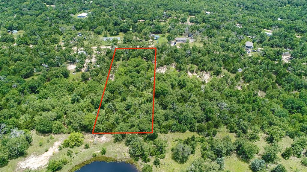 This 1.39 acre tract is FULL of character and charm and ready for you to make it your own! You heard me right, 1.39 ACRES! If you have been looking for a place close to Lake Somerville, this could be the spot for you! This property has TONS of beautiful established oak trees, and has a nice private feel. Whether you are looking for somewhere to build a permanent residence, or a weekend retreat to spend time at the lake, this is a great spot to make your own and enjoy the beauty of the outdoors! **Boundary lines drawn in photos are approximations and for illustrative purposes only.