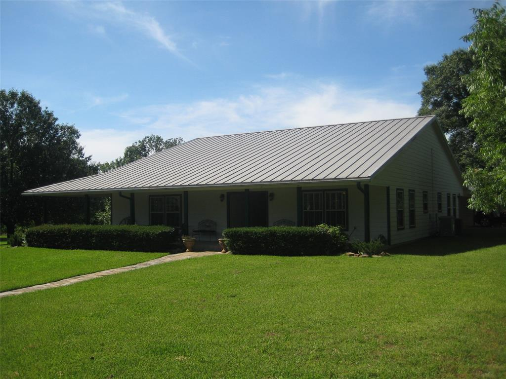 A hard to find 3 bedroom/ 3.5 bath home on acreage with paved road frontage. This property has all types of possibilities with this park-like setting including a pond. There is a shop and several outbuildings for storage as well as RV parking. Easy commute to Houston, Bryan/College Station, and Huntsville.