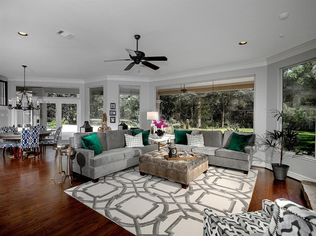 Fabulous T.D. Cox custom home on the golf course in Grogan's Point! Nestled on an oversized lot on a cul-de-sac street, this impeccably kept home features gorgeous hardwood floors, exceptional trim work, neutral paint palette, Plantation shutters, and walls of windows providing serene golf course views throughout. Open concept island kitchen with granite counters, stainless steel appliances and breakfast bar overlooks breakfast room and den; wine room with wet bar off kitchen; both formals; handsome wood paneled study with French doors and built-ins; two master retreats downstairs; all five bedrooms have walk-in closets and en-suite baths; large game room up with balcony; 3 car garage; private backyard in a park-like setting has multiple covered seating areas, outdoor kitchen and fire pit. Zoned to exemplary schools, Grogan's Point features tennis courts, area park, miles of hike/bike trails and close proximity to I-45 and Grand Pkwy for that commute!