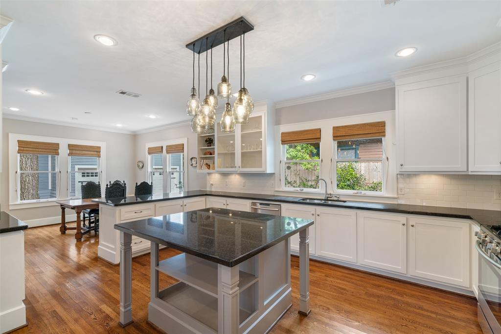 This kitchen island provides a wonderful gathering place for guests. It also provides a great space to have your morning coffee or serve breakfast to the family.