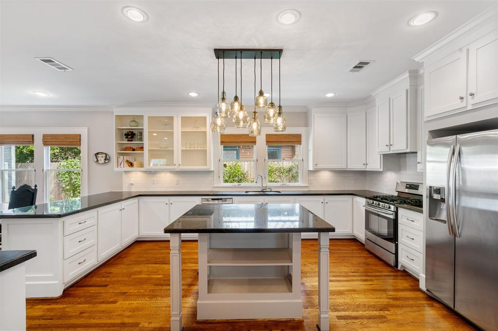 The chef in your family will love this spacious kitchen and they'll have plenty of space for their sous chefs as well. The kitchen features tons of counter space and custom cabinetry. The countertops are a beautiful black granite.