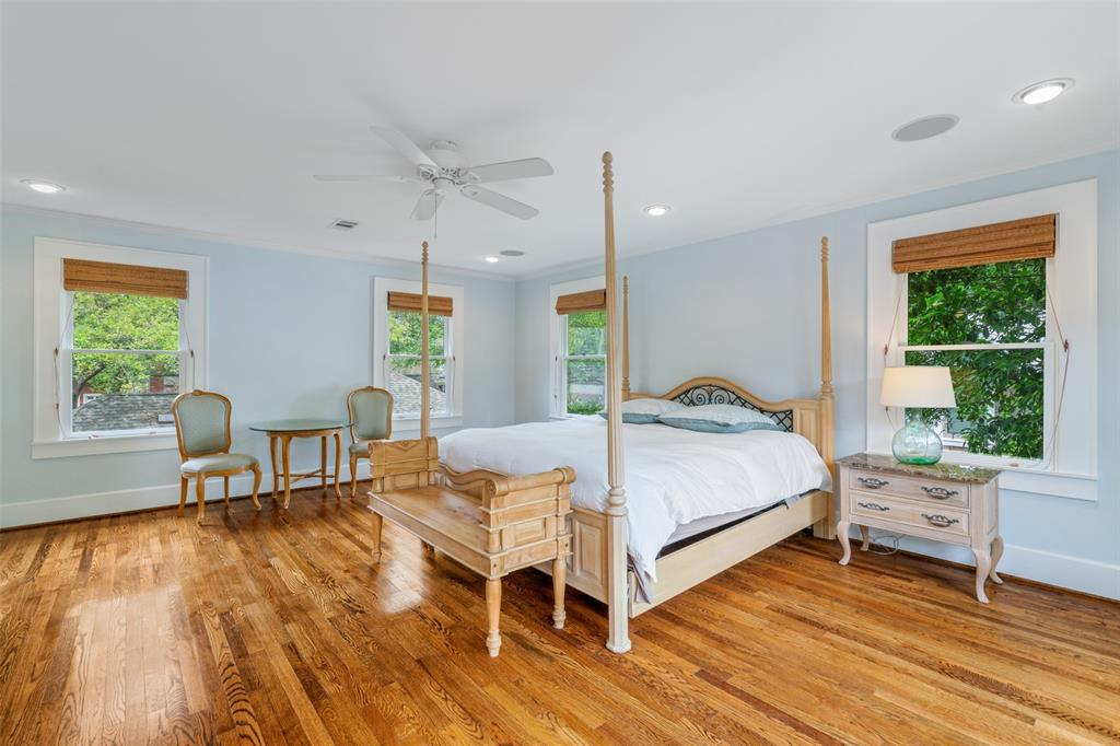 You are going to love this gorgeously lit master bedroom. You'll have no problem fitting your king sized bed and still have room for a relaxing sitting area.