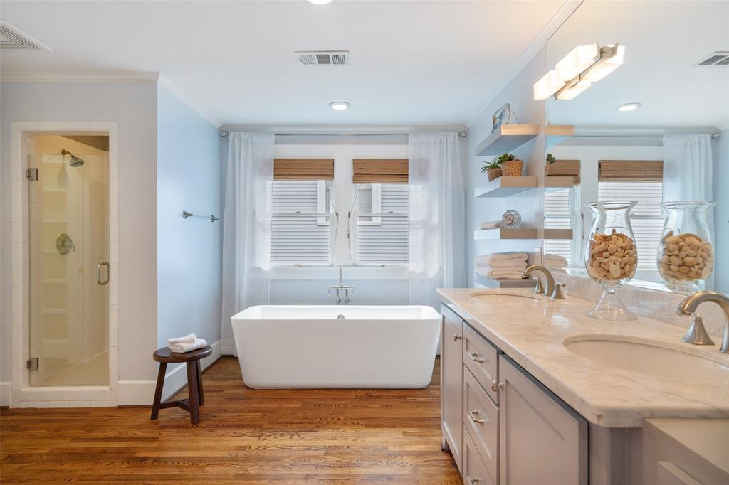 The master bathroom has a wonderful spa-like feel and includes a soaking tub and separate shower. After a long week, you'll love relaxing in this gorgeous standalone soaking tub.