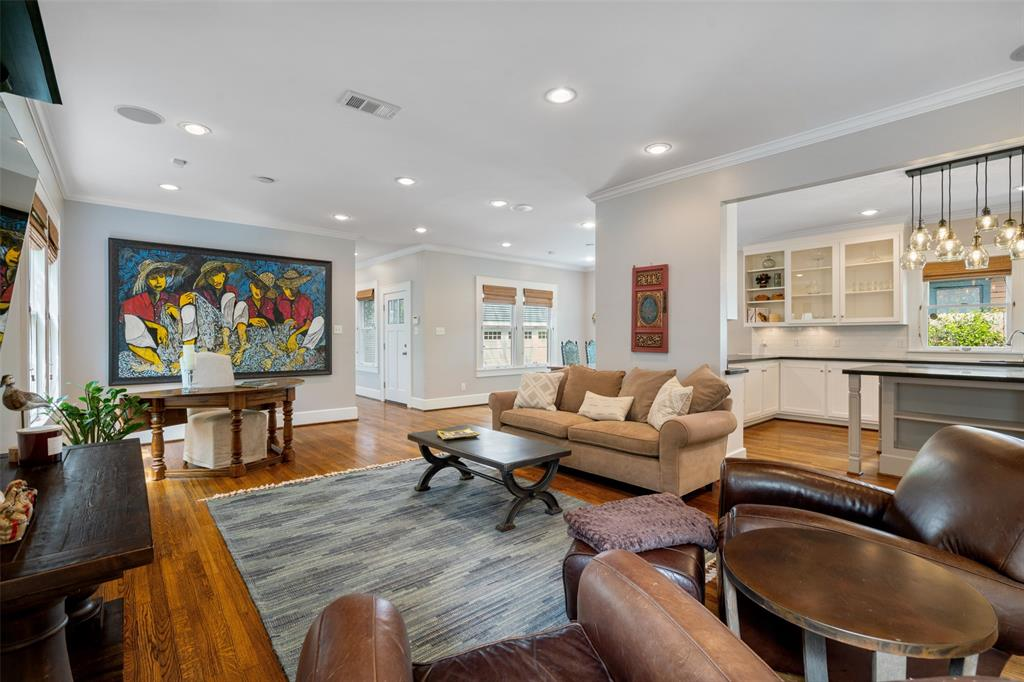 Per the seller, the main living area has been a wonderful space to entertain. These open spaces provide a comfortable space for large parties or holiday dinners. Like much of the home, the main living area includes beautiful oak floors, crown molding, and recessed lighting.