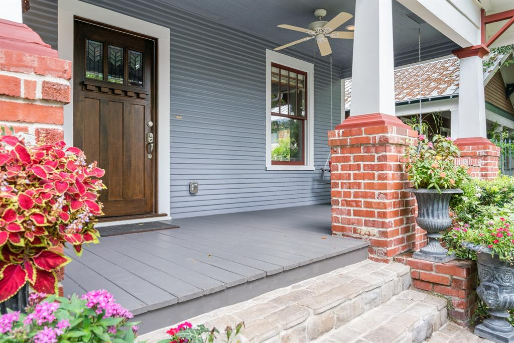 This historic Heights home includes many of the elements that you love about Houston Heights Bungalows, including these gorgeous craftsman style columns and front door.