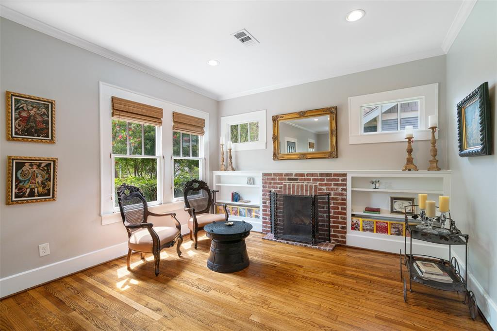 Enjoy a book by the fire on those lazy winter nights. This wood burning fireplace is flanked by built in bookcases beneath transom windows. You'll love the classic craftsman-style millwork throughout the home.