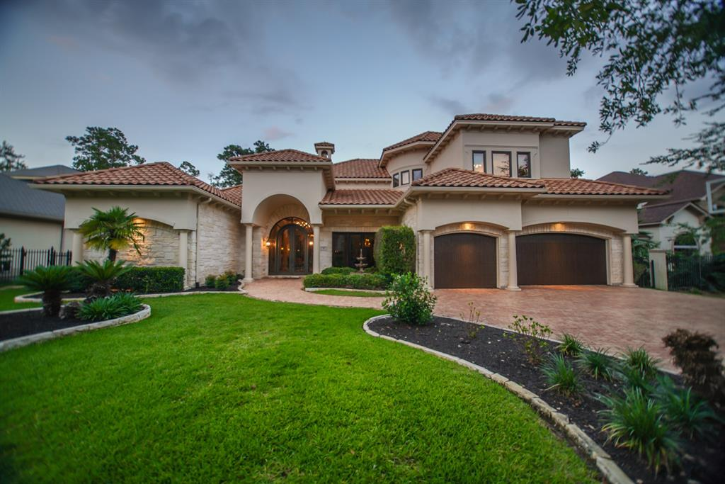 Absolutely stunning Custom home by Calli Homes featured in The Woodlands 2003 Showcase of Homes. Superb location on the Gary Player Course 13th Hole. Dramatic Iron & Glass double front doors welcome you into an Architectural image of quality with the spectacular foyer travertine floors. The exquisite formal Living Room features a fireplace overlooking an exceptional patio with a gorgeous swimming Pool, Spa and Fire pit to entertain family & friends. Elegant and executive private Study, Gourmet kitchen that features a high-end appliance package with a large island. You are going to love the Luxe owners retreat with a private seating area, Master Bathroom with Jacuzzi and elegant double sink cabinets! The open floor plan offers high ceilings, large windows, stone columns, rich textured walls with custom paint throughout. Second bedroom suite is located on the first floor. Updated Summer kitchen, elegant and well placed beams and corbels throughout home and your own gated wine Room.