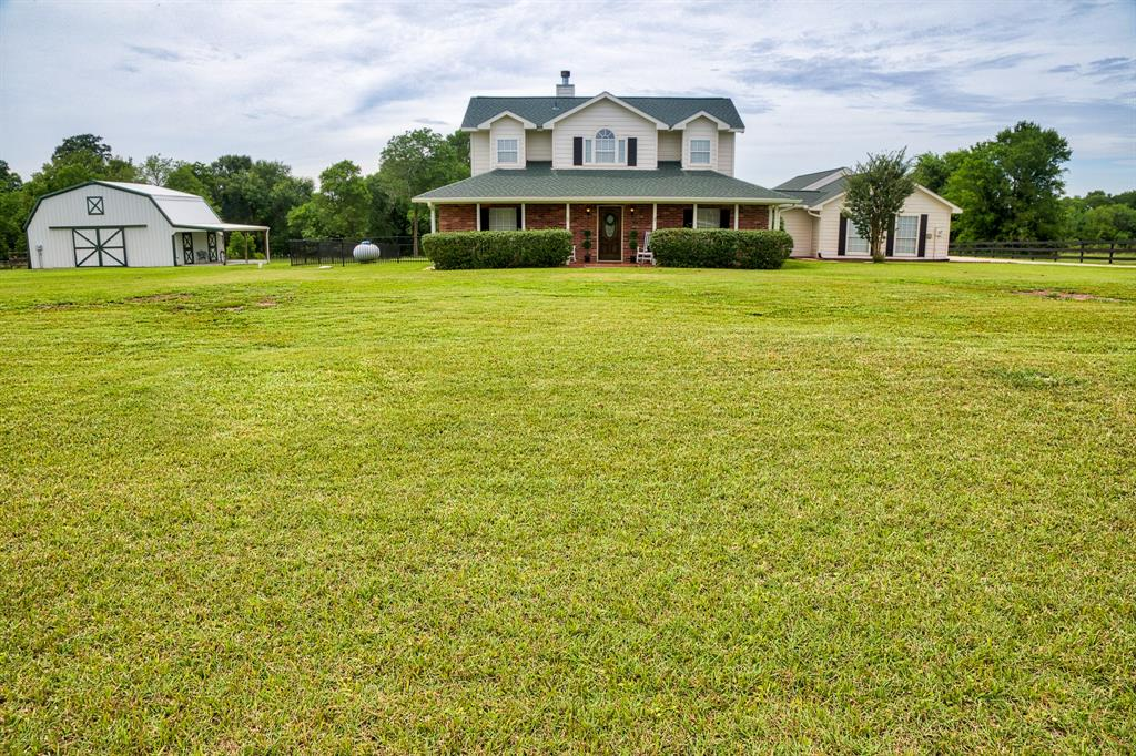 Welcome home to country living at this beautiful estate in Rolling Oaks. This two story home sits on over 5 acres, with a 3 car carport, Pool/spa, outdoor kitchen, approx. 1/4 acre pond, 24x36 wood frame metal building on slab with 10x15 tack room and a/c. A Mr. Mister mosquito system has been installed for those summer nights out on the patio. Master bedroom is located on the first floor, as well is a huge bonus room. This home is immaculate and a must-see! Upgraded features: Wood ceramic tile throughout 1st floor, kitchen updates completed in 2012, Complete Master Bath renovation in 2017, New roof 2018, New a/c in 2010, 2 car garage was converted into a living space that can serve as a bedroom, playroom, home gym or office space, New beautiful black wood fence was installed in 2019.