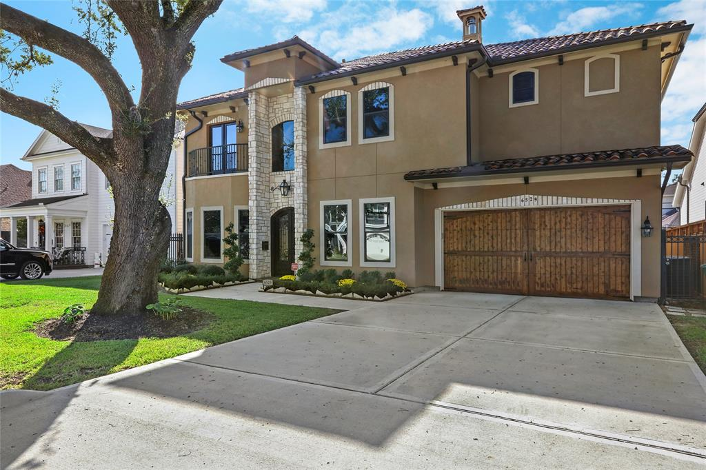 A mature Oak shades the front of this recently constructed Custom Home that's zoned to Memorial HS!  High end finish details throughout including wide plank hardwoods, 8ft solid core doors, soaring 11ft ceilings, 10in baseboards, Heat reducing window films for energy efficiency (Can be removed to allow more natural light in the home), built-in speakers, 4 security cameras, copper hammered sinks and custom site built cabinetry throughout. Kitchen features a Thermador appliance package includes 6 burner cook top and large built-in refrigerator. 1st floor Master features a huge walk-in closet and large bath with spa like shower!  2nd floor offers a game room, a media room and three additional secondary bedrooms each with a sizeable storage closet and a coffered ceiling.  Home also offers epoxy finish on garage floors, a deep covered back porch, a large backyard with plenty of room for a pool, a full lawn sprinkler system and is wired for alarm & so much more!