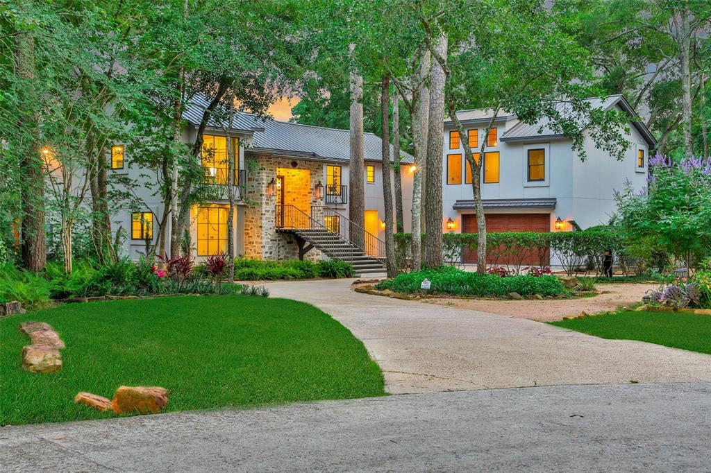 TAKE A PRIVATE TOUR: youriconteam.com/virtualwalkthrough/ New Construction built in 2019 at the front of THE WOODLANDS!!  Drenched in LUXURY, 1/2 acre CUL DE SAC lot on 17th hole of THE OAKS COURSE, mature trees alongside yard offers lots of privacy. WOODMODE HAMPTON style kitchen w/ WOLF, SUBZERO, ASKO appliances, BRIZIO faucet, & custom pullout drawers. RELAXING master retreat w/ fireplace, RESTORATION HARDWARE lighting & vanities, Quartz countertops, custom builts in closet w/ window box. Second master on 1st level w/ 8x11 sitting area. 60 foot ROOFTOP deck. GARAGE apartment w/ living, kitchen, 2 beds, & bath. GARAGE has an EXTRA room off of it w/ a shower & door exits to backyard - great feature for the future pool addition. Construction includes NEW roof, wiring, plumbing, HVAC, spray foam insulation, Anderson E series architectural windows & doors, hardwood & tile flooring. ZONED to CONROE ISD. Don't miss this RARE opportunity - NEW CONSTRUCTION at the front of THE WOODLANDS.