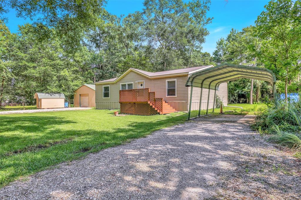 Commercial & Residential Options on this UNRESTRICTED 1/2 acre property located at the entrance to Carriage Hills and Jacob's Reserve and just minutes from The Woodlands, Spring, Conroe, & Magnolia. Well kept and clean manufactured home that would work well as an office space, or live here and use the other buildings for your small business.  720 sq. ft. warehouse with industrial racks and front and rear garage doors makes a great workshop or storage space. Small shed can be used for office space or storage. Incredible location with easy access to I-45.