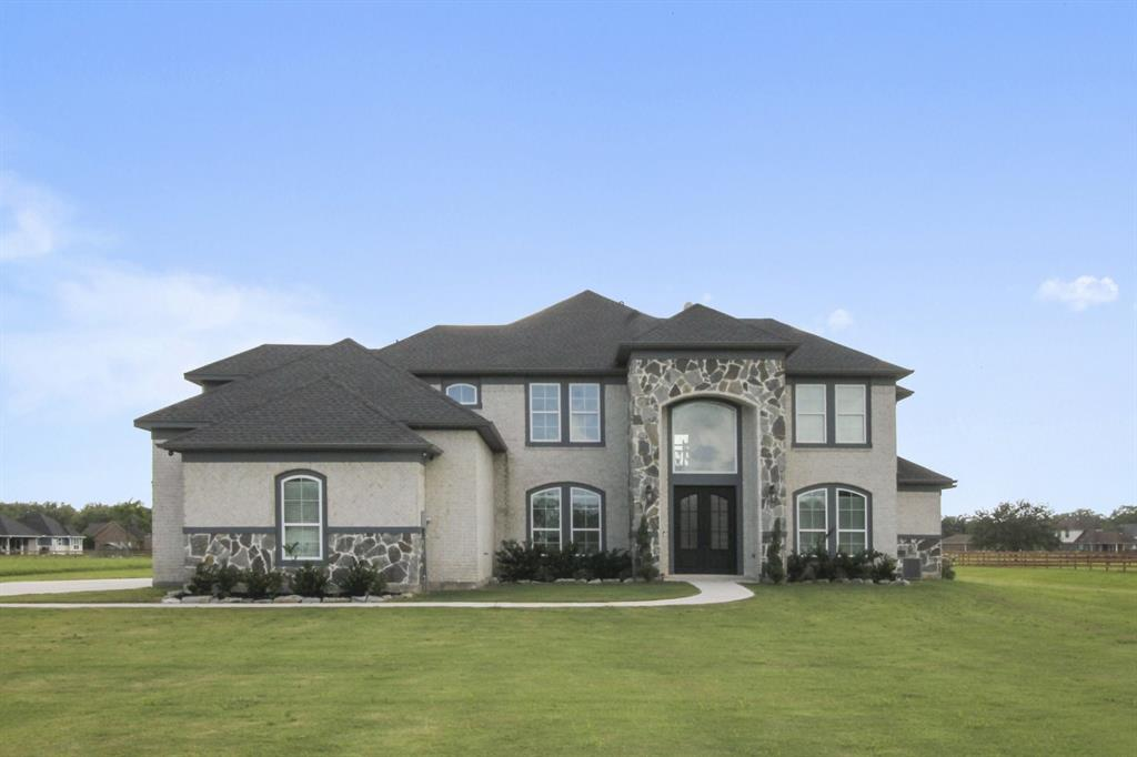 Stunning 5 BR home with 3-car garage on 2 acres. A beautiful winding staircase greets you as you enter your new home. The chef's kitchen features stainless steel appliances, double ovens, gas cooktop, walk in pantry and breakfast area.  Family room has soaring ceilings and wall of windows with great views of the expansive backyard. Large formal dining room and study. Luxurious master suite and bath features whirlpool tub accented by a TV and private gas log fireplace. Second bedroom downstairs with private bath. Three bedrooms upstairs plus a Jack and Jill bath. Exercise room plus a fantastic game/media room complete with kitchenette. Large mud/utility room.  Easy access to 288.  Come see today!