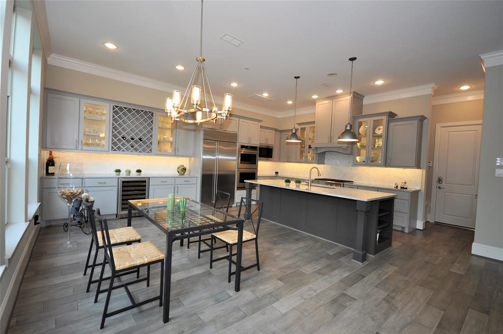 IMMACULATE 2017 DAVID WEEKLY 4/5 BED, 2 CAR GARAGE, 4/1 BATH. 20 HOME - GATED COMMUNITY IN SPRING VALLEY ZONED TO MEMORIAL HIGH SCHOOL. THIS BEAUTIFUL FIRST FLOOR LIVING OPEN PLAN HOME HAS UPGRADED FINISHES THROUGHOUT INCLUDING HARD WOOD FLOORS ON THE FIRST FLOOR & STAIRS. GORGEOUS HUGE KITCHEN WITH BIG BREAKFAST BAR, GRANITE COUNTERS, DOUBLE TRASH DRAWER, DOUBLE OVEN, 6 GAS BURNER, UPDRAFT VENT HOOD, CUSTOM PANTRY. BUFFET WITH WINE BAR & BUILT INS. BREAKFAST ROOM WITH WALL OF WINDOWS OUT TO BACK YARD. LARGE LIVING ROOM WITH GAS FIRE THROUGH TO LARGE DINING ROOM TO THE FRONT OF THE HOME. HUGE MASTER SUITE WITH 2 LARGE CLOSETS, 2 FURTHER BEDROOMS WITH EN SUITE BATHROOMS ON 2ND FLOOR & LARGE GAME ROOM WITH DRY BAR AND REFRIGERATOR 4 TH BEDROOM WITH EN SUITE BATH ON 3RD FLOOR EFL DIAMOND BUILDER HEATING & COOLING SYSTEM FOR LOW UTILITY BILLS. LARGE COVERED PATIO - GREAT FOR ENTERTAINING WITH PLUMBING FOR OUTDOOR KITCHEN. FULLY LANDSCAPED YARD MAINTAINED BY HOA.