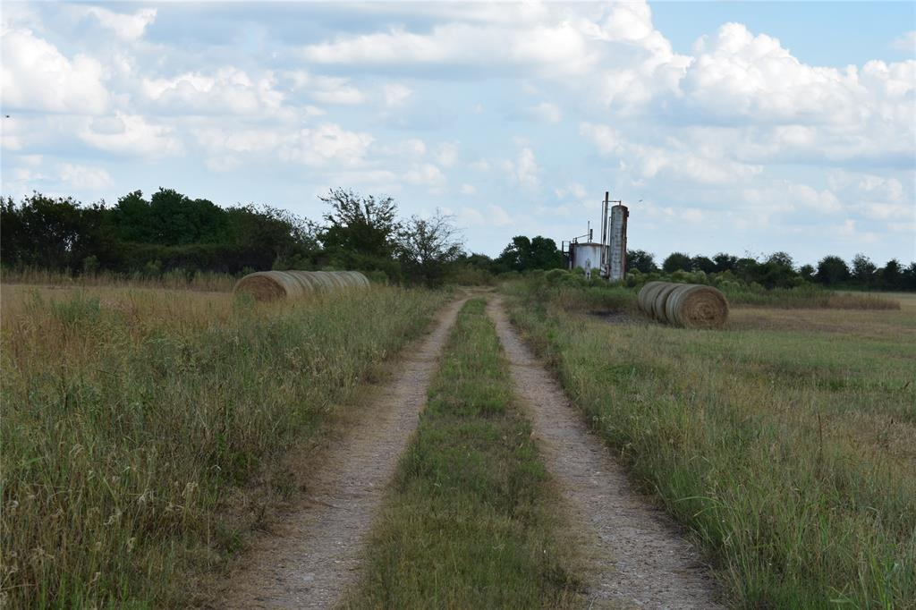 32.742 AC close, between Eagle Lake and Sealy. Former rice field. Access by easement. Active drill site on land. Survey in attachments.