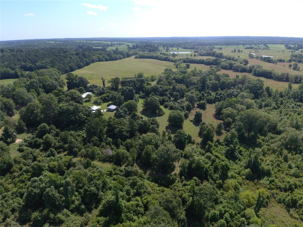 You don't want to miss out on this BEAUTIFUL 71.78 acre tract of land full of potential to make it your own. The property could be the perfect weekend-getaway or the perfect place to build your dream home. It already features a 2 bedroom, 1 bath cabin equipped with water and electric. There is a large room attached that has the potential to be another living area or more bedrooms. The roof was replaced approximately 5 years ago, it has a fresh paint job, and tankless water heater. There is a creek running the width of the tract that is the perfect place for wildlife to linger. The property also has a shop with plenty of space to store tools or hunting gear. The pole barn behind the shop has plenty of space to store boats, ATV's, and tractors. If you are looking for the place to build your dream home, this wooded tract is ready to be logged or cleared. With the beautiful rolling hills, you would have a perfect location to enjoy for years to come. Get it before it's gone!