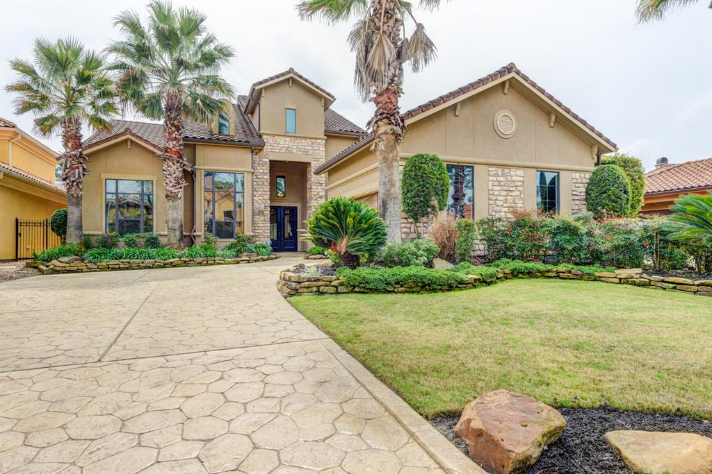 """This incredible home is located on the 7th hole of the Northgate Forest Golf Course and Country Club Community. A beautifully manicured, secure, gated and maintenance free community courtyard home. No back neighbors and has open views of the golf course and pond from the covered patio and summer kitchen, or from the huge upstairs balcony. An exclusive stucco & stone home w/tiled roof. Decorated & landscaped in beautiful detail & design. Custom window treatments, beautiful ceiling detail, travertine, hardwoods & gorgeous upgraded lighting fixtures. French doors lead to small private patio off the dining room. Enjoy 3 """"living"""" areas"""" (two down and one up). Exquisite living room, open concept & wonderful views. Relax & enjoy watching your favorite team in the downstairs wine room & full bar. Upstairs is a gameroom, loft w/bookcases & desk, & walk-in bar. A flex room, Media room or Exercise room. New water heater! Mosquito mist system! This beautiful home is a great find with many extras!"""