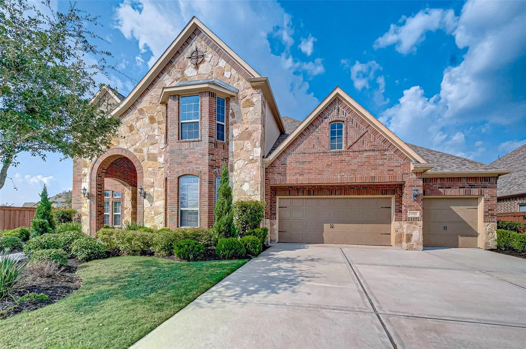 Welcome to the Luxury lovers dream home nestled on a huge corner lot. You will be welcomed by a breathtaking spiral staircase and a study with a closet and french doors, which can be used as an extra bedroom so you can have 3 bedrooms downstairs. The extended huge island kitchen is every chef's dream which is facing the outside patio. You will be amazed to see the Texas-size covered patio which will be a great relaxing zone for cozy evenings and outdoor parties. The spacious living area, formal dining, study, and staircase has fresh hardwood floors installed right before listing the house. Master bedroom is enormous with a great sitting area in bay window. Your master bath has a soaking tub plus an upgraded walk-in shower. Upstairs you have a spacious game room, a media and 3 bedrooms. There is also an extra half bath upstairs. Don't miss the chance to own it! Watch the video and be amazed!