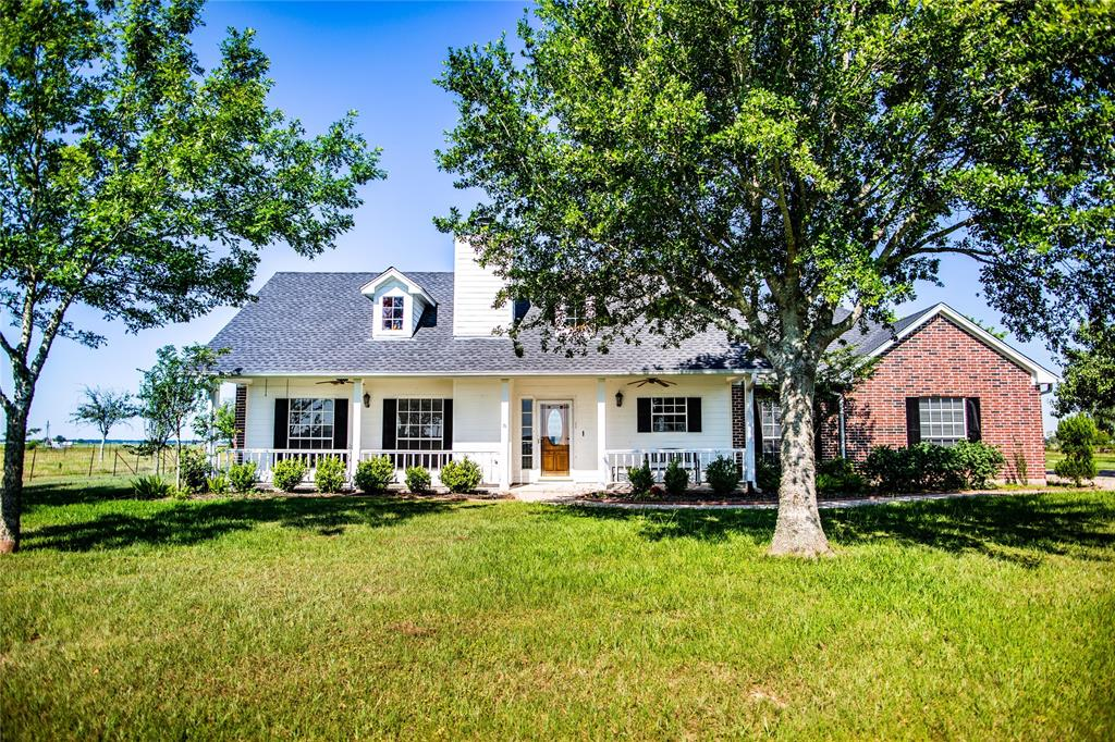 Welcome to 5227 CR 264! This beautiful property out on the prairie offers 10 acres of fenced pasture and mature trees! The home on this land is a 4 bedroom, 2 bath with a huge living room and sun room! It is 2212 sq ft of country living!   The new barn, fully insulated, built in 2016 has a 90x60 workshop space AND 1900 sq. ft. of beautiful living space in the front! The master bedroom and bath is downstairs along with the kitchen, living, dining and a laundry room! The upstairs has 2 big bedrooms, walk in closets and another full bath with tons of storage! The workshop part of the barn has a manual roll up door and 2 garage doors with openers! This unique property is a MUST SEE!