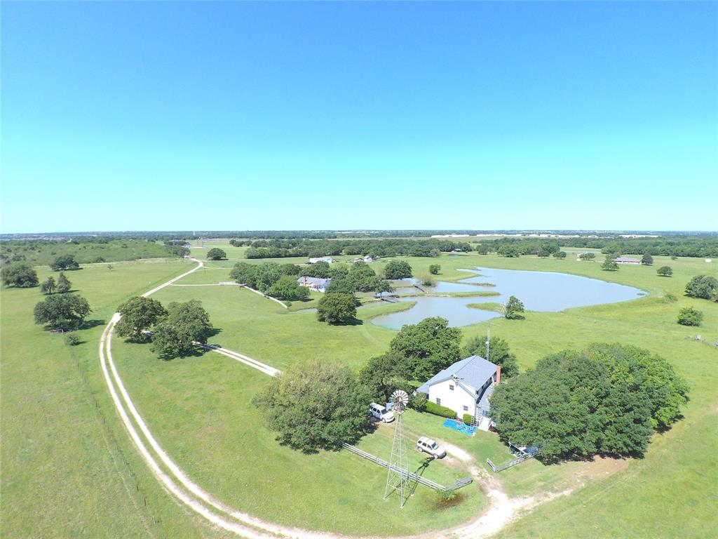 Remarkable historic ranch in Brazos County. Two lovely homes! Main residence is a 1986 build offering 3 XL bedrooms and 2 baths with 2 living spaces. NEW ROOF, GUTTERS, and AWNING 2020. Secondary circa 1920's historic bed and breakfast residence is 1848 sq ft model with a lot of original flare, charm and wood floors. This residence borders a beautiful 6+ acre stocked lake. Many weddings, reunions, and special events have been hosted here.  other ranch amenities are a 1995 built 1800 sq ft metal workshop, working pens, cross fencing, ponds, and improved pastures. Main residence on Wickson Water District. ASK ABOUT POSSIBLE TERMS.